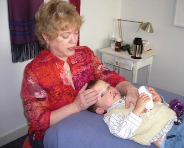 Judith Sullivan using CranioSacral Therapy, Zero Balancing and Visceral Manipulation to help a child heal.